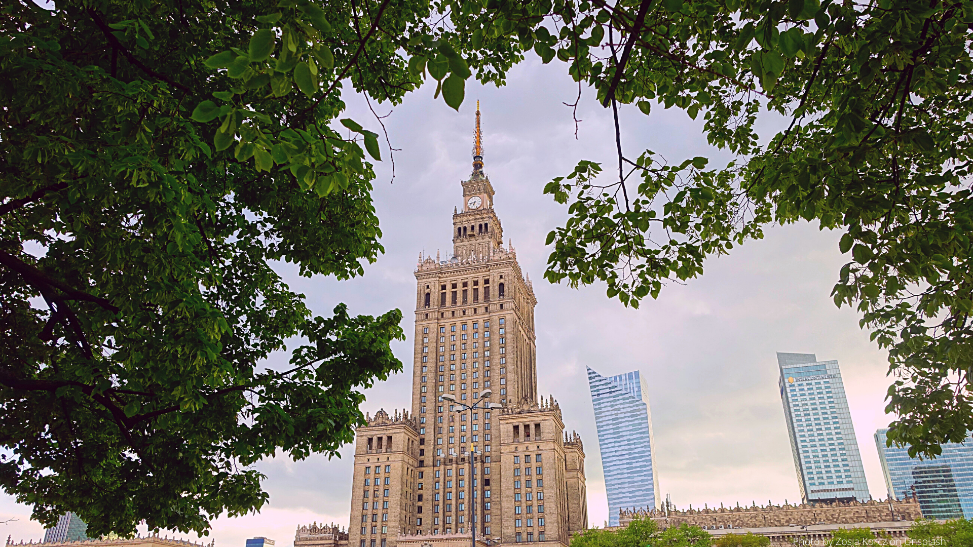 Photo of the Palace of Culture in Warsaw, an example of Socialist Architecture by Zosia Korcz on Unsplash